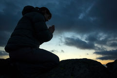 Woman Praying. A woman praying to God on the summit of a mountain Royalty Free Stock Images