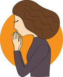 Woman prays. Woman in dark clothes with brown hair praying Royalty Free Stock Photo