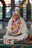 A woman prays in the mosque Stock Photo
