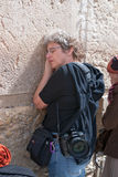 A woman prays at the Wailing Wall. Stock Images