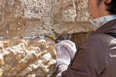 A woman prays at the Wailing Wall. Royalty Free Stock Images