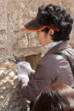 A woman prays at the Wailing Wall. Royalty Free Stock Photos