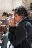 A woman prays at the Wailing Wall. Stock Image