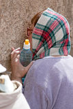 A woman prays at the Wailing Wall. Stock Photo