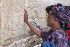 A woman prays at the Wailing Wall. Royalty Free Stock Photography