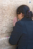 A woman prays at the Wailing Wall. Stock Photo