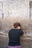 A woman prays at the Wailing Wall. Stock Image