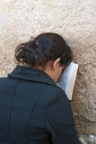 A woman prays at the Wailing Wall. Royalty Free Stock Image