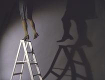 Woman precariously on ladder Royalty Free Stock Images