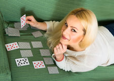Woman predicting future with cards Stock Images