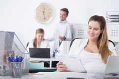 Woman during pregnancy and career Stock Image