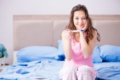 The woman with pregnancy results test Stock Photo