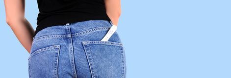 Woman with pregnancy test in pocket jeans. Pregnant test. Woman with pregnancy test in pocket jeans Royalty Free Stock Photos