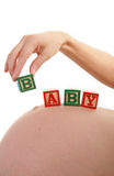 Woman pregnant and baby cube Royalty Free Stock Photos