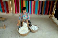 Woman prepare cotton fibers Stock Images