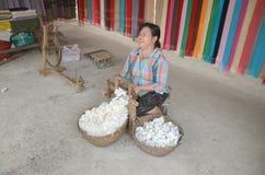 Woman prepare cotton fibers Stock Photos