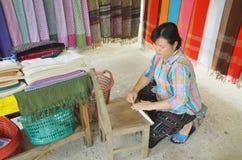 Woman prepare cotton fibers Royalty Free Stock Photo