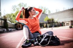 Woman prepare for exercise. Outside. Close up image Stock Image