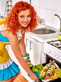Woman prepare fish in oven Stock Photography