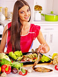 Woman prepare fish in oven. Royalty Free Stock Images