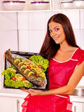 Woman prepare fish in oven Stock Image