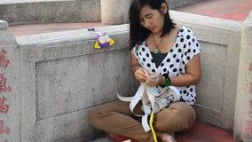 Woman prepare joss paper for burn in the Qingming Festival stock video