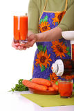 Woman prepare Juice extractor and carrot Royalty Free Stock Photo