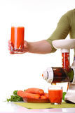 Woman prepare Juice extractor and carrot Royalty Free Stock Photography