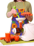 Woman prepare Juice extractor and carrot Stock Photos