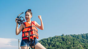 Woman prepare for snokelling. Asian woman prepare for snorkelling Royalty Free Stock Photos