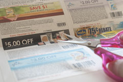 Woman prepare to cut coupon. All coupons for Canadian store, they are issued by manufacturers of consumer packaged goods Canada Royalty Free Stock Photos