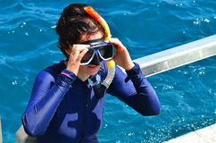 Woman prepare to  snorkeling dive. In the Great Barrier Reef Queensland Australia Royalty Free Stock Image