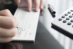 Woman prepare writing a check. Business woman prepare writing a check Royalty Free Stock Photography