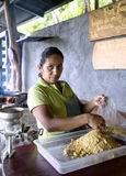 Woman prepares from corn flour tortillas Stock Images