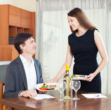 Woman prepares dinner for man Stock Photography