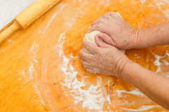 Woman prepares dough on board Royalty Free Stock Photography