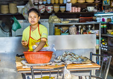 Woman prepares food in an eating house in Bangkok Stock Photo
