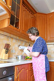 A woman prepares food using a mixer Stock Photography
