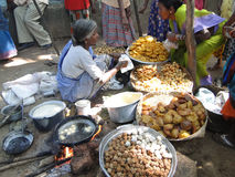 Woman prepares fried food Royalty Free Stock Image