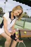 Woman Prepares Herself To Play Tennis Stock Photo