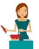 A woman prepares. Housewife holding a spoon over a saucepan Stock Photos