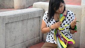Woman prepares joss paper for burn in the Qingming Festival stock video