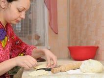 The woman prepares a pie Royalty Free Stock Photo