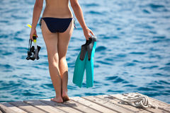 Woman prepares for snorkeling Royalty Free Stock Image