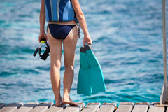Woman is prepares for snorkeling or diving with equipment for sn Stock Images