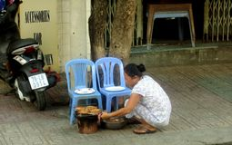 The woman prepares the street royalty free stock photography