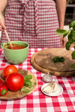 Woman prepares a tomatoe sauce Stock Photo