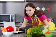 Woman prepares vegetables Royalty Free Stock Photo
