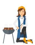 Woman preparing barbecue Stock Photo
