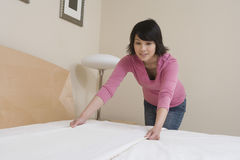 Woman Preparing Bed At Home Stock Photos